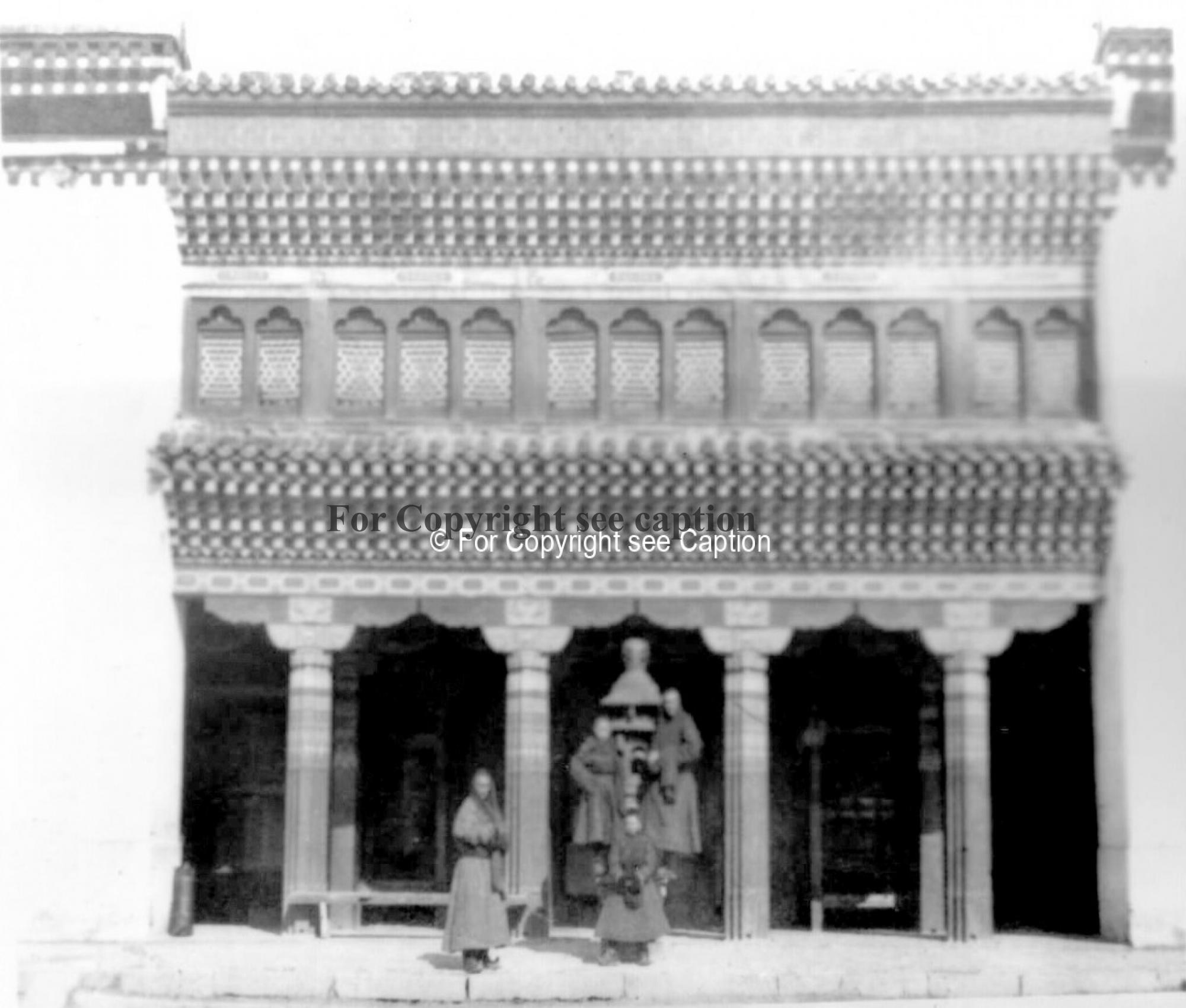 Entrance of the main assembly hall with an incense vessel (boipor) and four novices. Film Archives ?